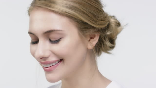 portrait of beautiful smiling woman with hairstyle - blond hair stock videos & royalty-free footage