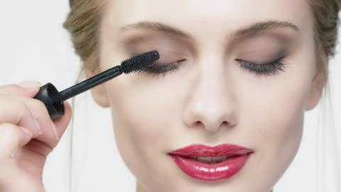 portrait of beautiful woman applying mascara - eyelash stock videos & royalty-free footage