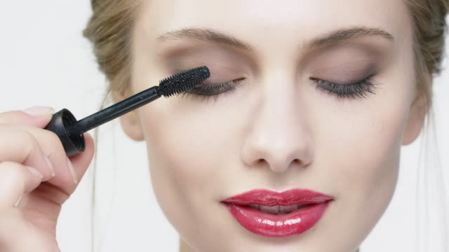 portrait of beautiful woman applying mascara - make up stock videos & royalty-free footage