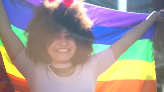 portrait of beautiful woman during lgbtqi parade - pride stock videos & royalty-free footage
