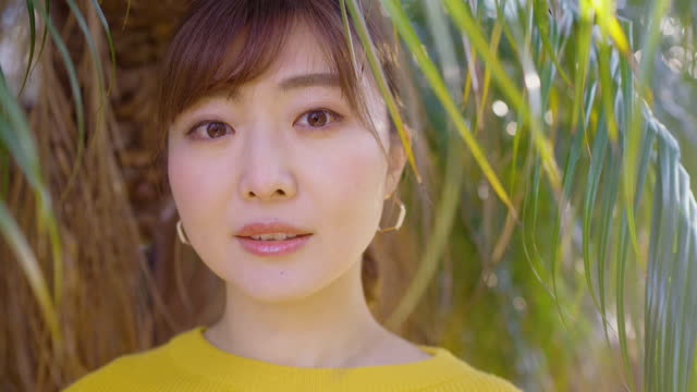 portrait of beautiful woman in yellow sweater in nature - east asian ethnicity stock videos & royalty-free footage