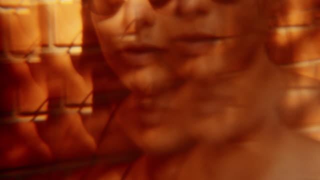 stockvideo's en b-roll-footage met portret van mooie vrouw - stone object
