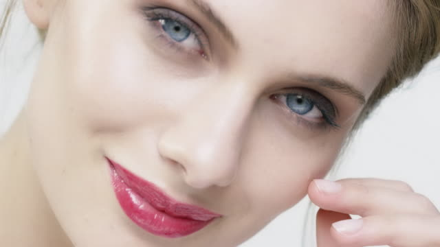 portrait of beautiful woman wearing red lipstick - glamour stock videos & royalty-free footage