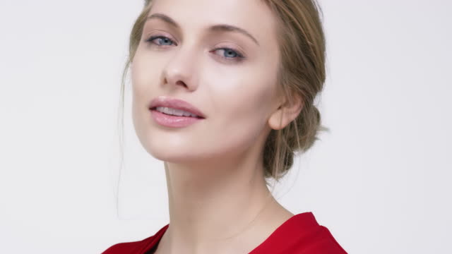 portrait of beautiful woman wearing red top - top garment stock videos & royalty-free footage