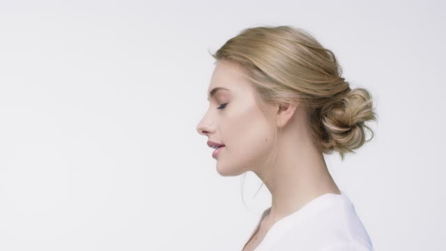 portrait of beautiful woman with blond hair - side view stock videos & royalty-free footage