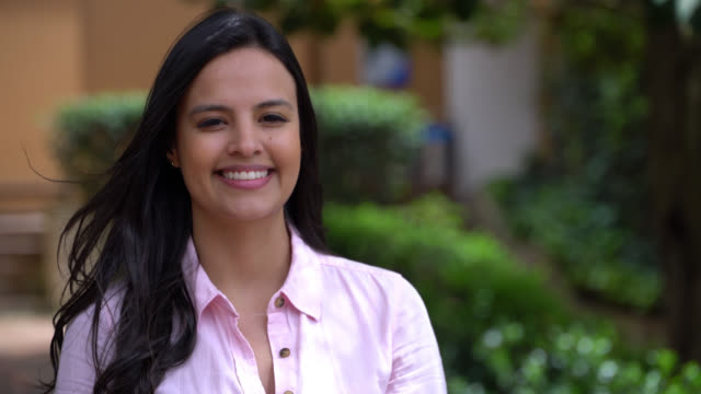 portrait of beautiful young student looking at camera smiling - adult stock videos & royalty-free footage