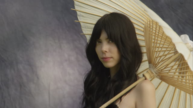 portrait of beautiful young woman standing with parasol looking at camera - new paltz ny stock videos and b-roll footage