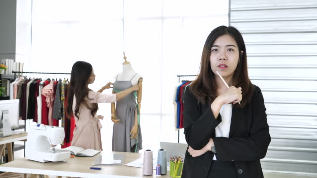 portrait of beautiful young woman tailor - atelier fashion stock videos & royalty-free footage