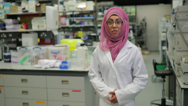 portrait of biology expert in the lab - hijab stock videos & royalty-free footage
