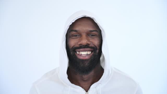portrait of black man in 30s wearing sweatshirt with hood - sweatshirt stock videos & royalty-free footage
