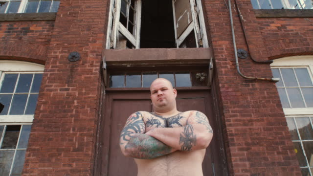 MS LA Portrait of bodybuilder in front of deserted factory, Middletown, Connecticut, USA