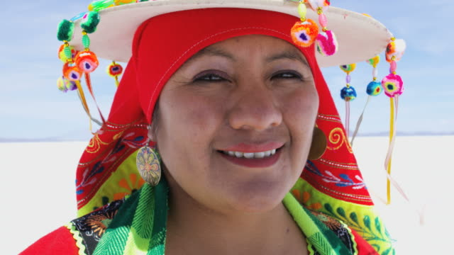 portrait of bolivian female on mineral salt flats - native american ethnicity stock videos & royalty-free footage