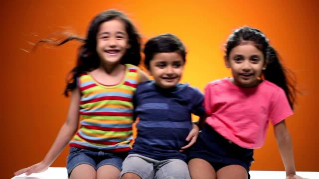 Portrait of boy and girls enjoying