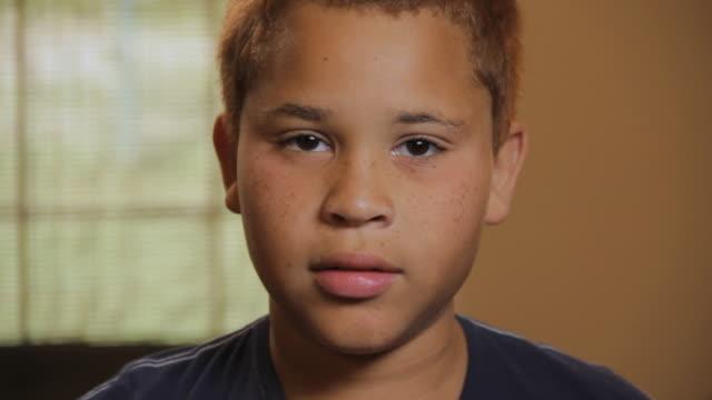 CU Portrait of boy (10 -11) in 'I don't buy it' fashion / Madison, Florida, USA