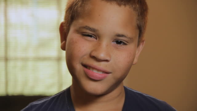 cu portrait of boy (10 -11) smiling and nodding not convinced / madison, florida, usa - agreement stock videos & royalty-free footage
