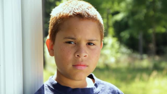 CU Portrait of boy (10 -11) smiling / Madison, Florida, USA