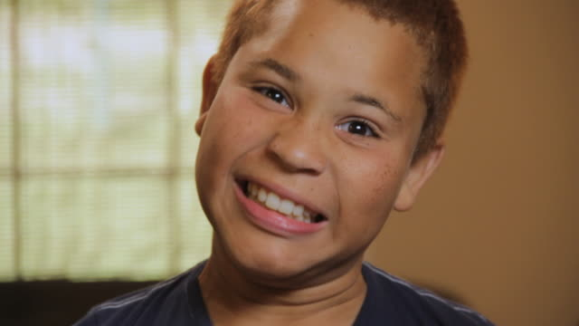 cu portrait of boy (10 -11) smiling playfully / madison, florida, usa - freckle stock videos & royalty-free footage