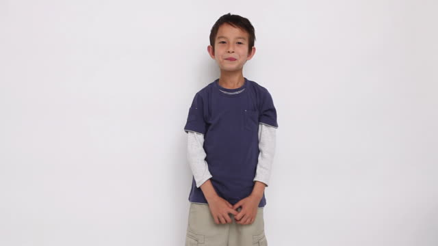 ms portrait of boy (8-9) standing in studio / shibuya, tokyo, japan - shy stock videos & royalty-free footage