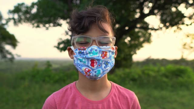 portrait of boy wearing facial mask - childhood stock videos & royalty-free footage