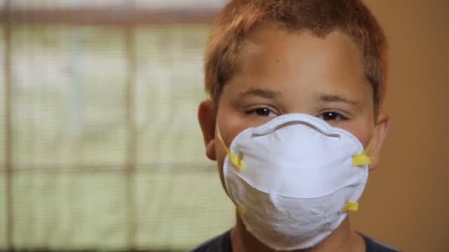 CU Portrait of boy (10 -11) wearing protection mask / Madison, Florida, USA