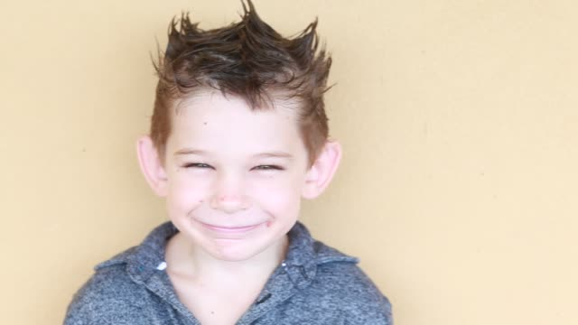 portrait of boy with funny hair smiling - kelly mason videos stock videos & royalty-free footage
