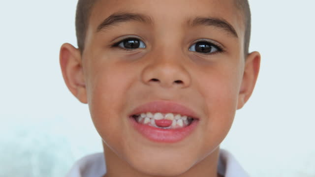 cu portrait of boy (6-7) with missing teeth / jersey city, new jersey state, usa - 歯点の映像素材/bロール