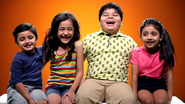 portrait of boys and girls smiling - coloured background stock videos and b-roll footage