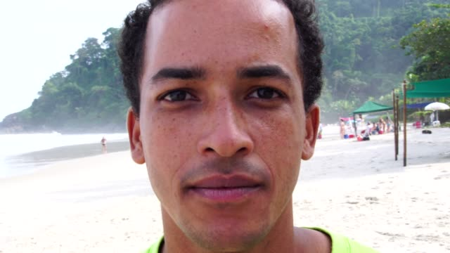 portrait of brazilian men at the beach - front view stock videos & royalty-free footage