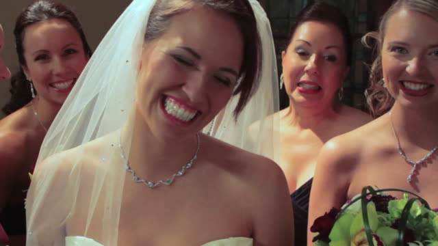 vídeos de stock, filmes e b-roll de portrait of brides, mother and bridesmaids laughing - bridesmaid