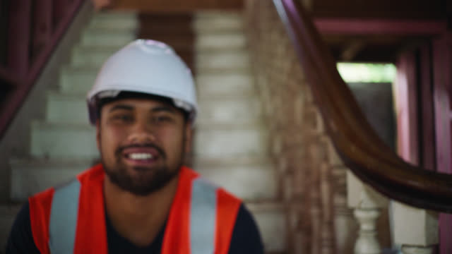 Portrait of builder on construction site