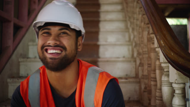 Portrait of builder on site with laugh