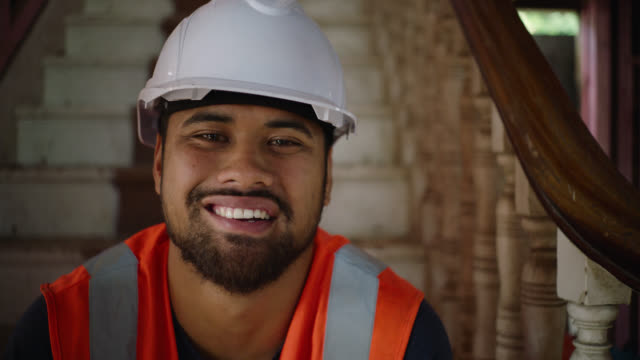 portrait of builder on site with laugh - pacific islanders stock videos & royalty-free footage