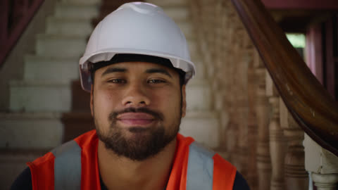 portrait of builder on site with smile - pacific islander stock videos & royalty-free footage