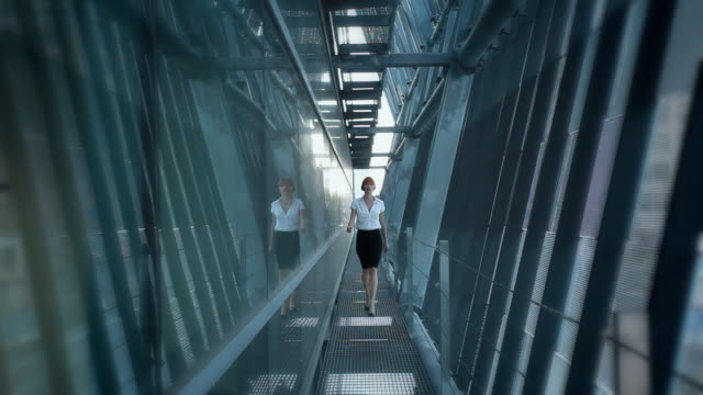 WS CU R/F Portrait of business woman approaching camera in walkway, Los Angeles, California, USA