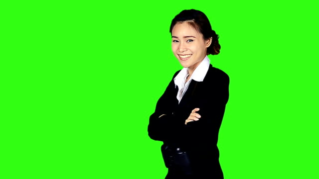 stockvideo's en b-roll-footage met portrait of business woman with binocular on green screen background - keyable