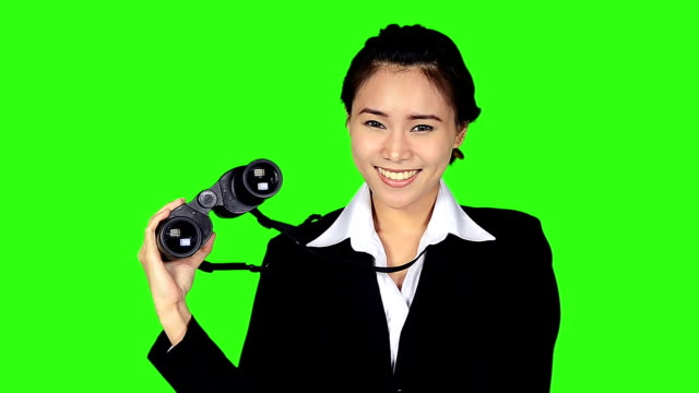portrait of business woman with binocular on green screen background - keyable stock videos & royalty-free footage