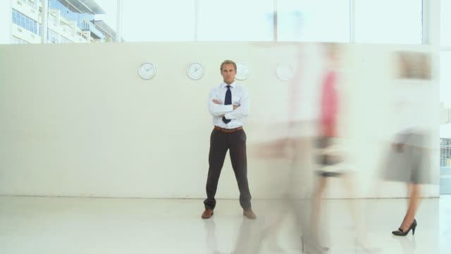 WS Portrait of businessman, blurred in motion people in foreground, Cape Town, South Africa