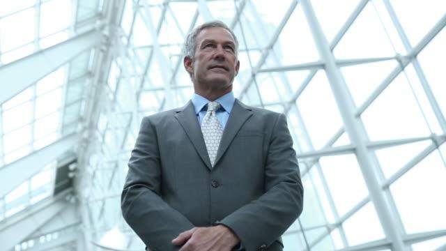 Portrait of businessman looking up