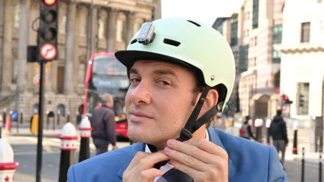 portrait of businessman putting on and removing bike helmet - only mid adult men stock videos & royalty-free footage