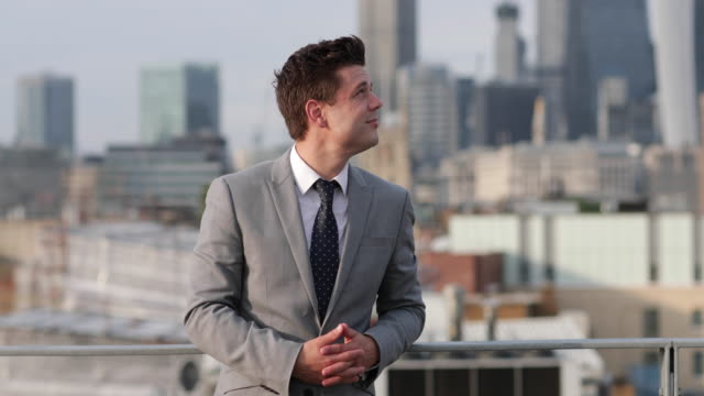 portrait of businessman with london city skyline - dach stock-videos und b-roll-filmmaterial