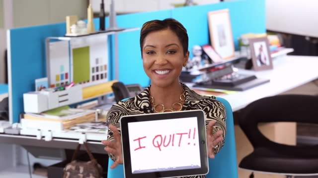 """ms portrait of businesswoman holding tablet computer with the message """"i quit!!"""" / richmond, virginia, usa - sign stock videos & royalty-free footage"""