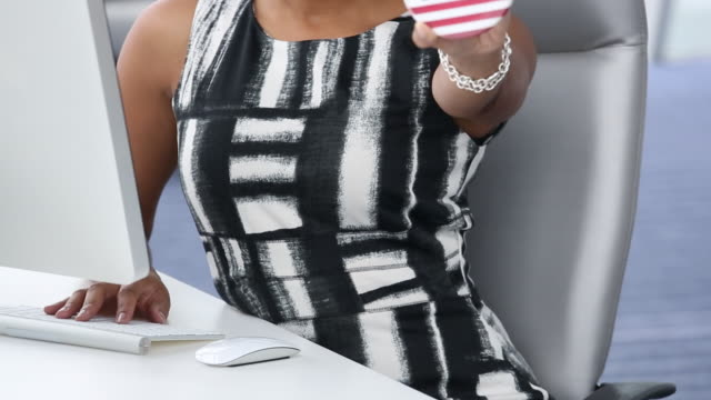MS DS TU Portrait of Businesswoman Holding VOTE Pin in Corporate Office / Virginia Beach, Virginia, United States