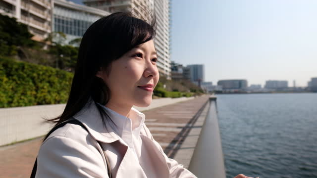 portrait of businesswoman looking at view - one mid adult woman only stock videos & royalty-free footage