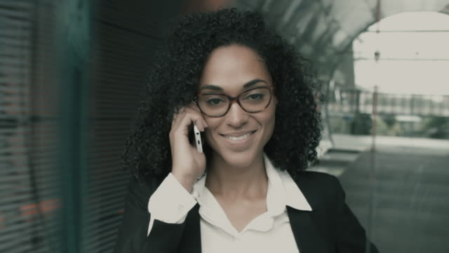 Portrait of businesswoman on phone, smiling