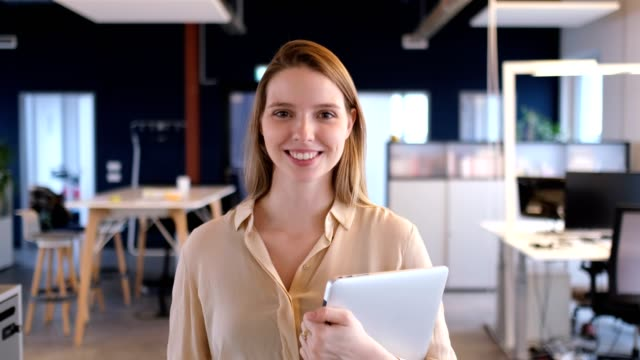 portrait of businesswoman smiling in office - blonde hair stock videos & royalty-free footage