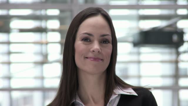 cu pan portrait of businesswoman standing in office building, copenhagen, denmark - straight hair stock videos & royalty-free footage