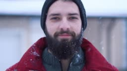 Portrait of calm bearded man looking in camera close-up.