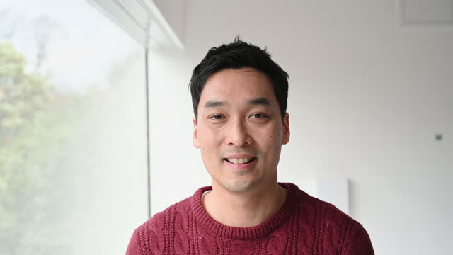 portrait of casual chinese man at home - content stock videos & royalty-free footage