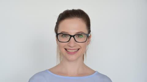 portrait of caucasian businesswoman wearing eyeglasses - white background stock videos & royalty-free footage