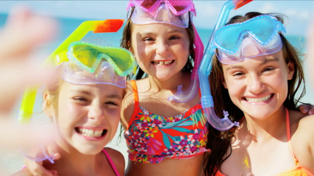 Portrait of Caucasian girls snorkeling on beach vacation